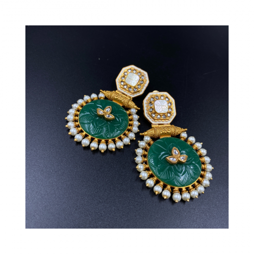 Fancy Earrings With Natural Green Stone And In Combination Of Mother Of Pearl And Kundan